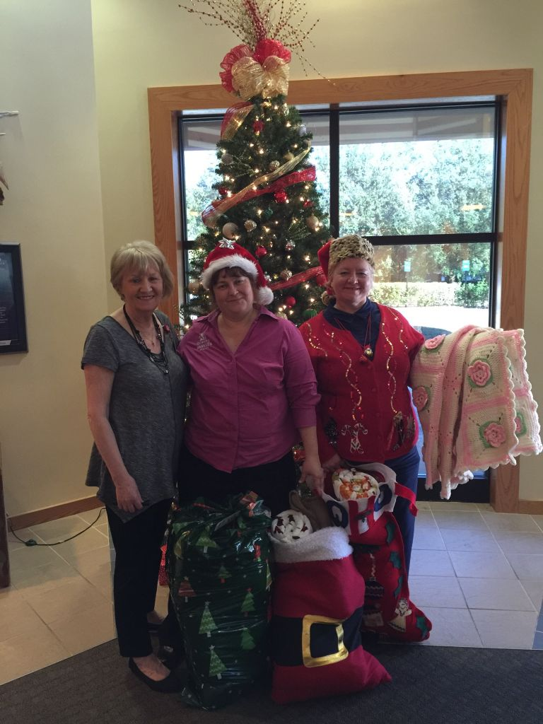 Granny NANNIES staff with some of the donated blankets.